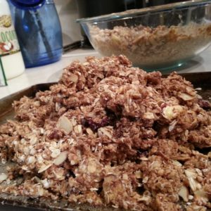 Spread granola on cookie sheet and bake.  Be sure to stir every 5 minutes.