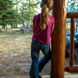 Emily on the deck of the cabin