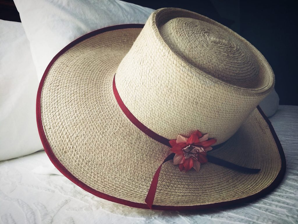 Straw hat with paper flower