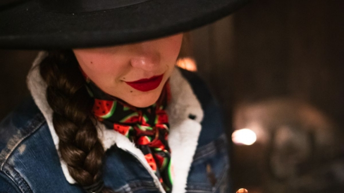 cowgirl in a black hat with red lips