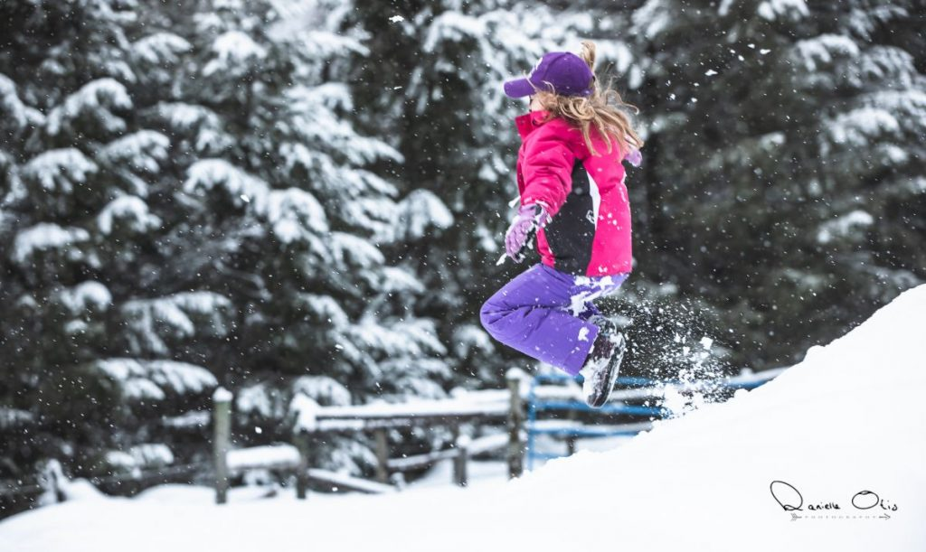 Girl jumping into the snow